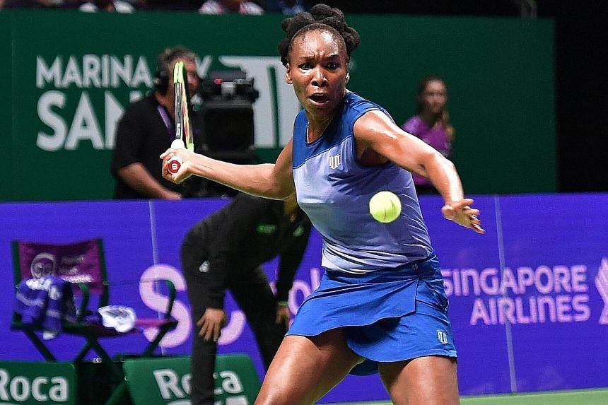 Venus Williams in action against Jelena Ostapenko yesterday, in a match that lasted three hours and 13 minutes and included 20 service breaks. The American won 7-5, 6-7 (3-7), 7-5 to register her first victory of the week.