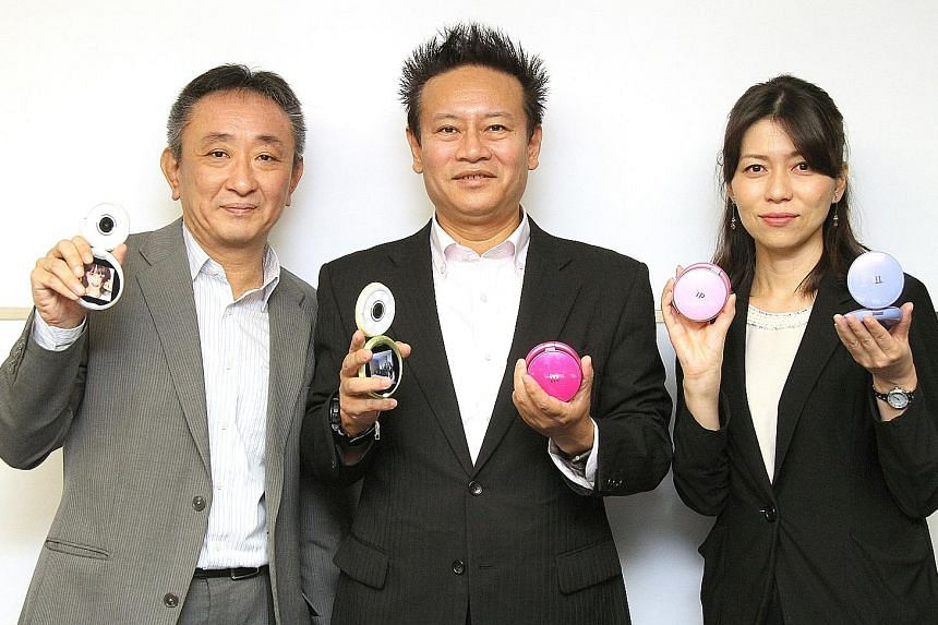 The Casio team taking a wefie. The eight LED lights around the lens cast even lighting on the subject. Showing off the TR Mini are (from left) Mr Koichi Matsuzaki, manager of Casio's global marketing for digital cameras; Mr Junichi Miyasaka, who was