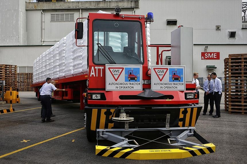 Katoen Natie's driverless truck, which is in use at ExxonMobil's site on Jurong Island, travels along a fixed route to transport polymer products.