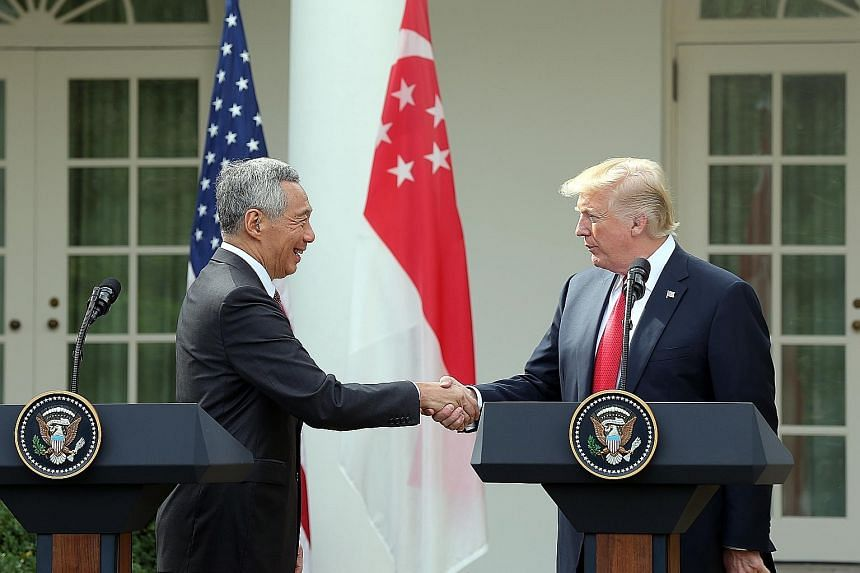 """Prime Minister Lee Hsien Loong with US President Donald Trump at the Rose Garden of the White House on Monday. Both leaders spoke of the robust and enduring relationship between their two countries, with Mr Trump saying: """"We are fortunate to have suc"""
