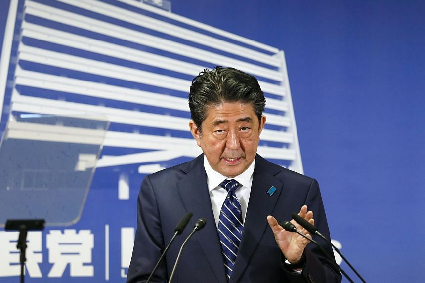 Japanese Prime Minister Shinzo Abe speaks during a news conference at headquarters of the ruling Liberal Democratic Party (LDP) in Tokyo.