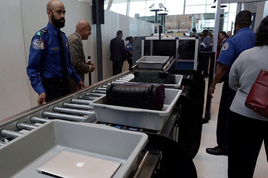 New security measures, including stricter passenger screening, take effect on Oct 26 on all US-bound flights, to comply with government requirements designed to avoid an in-cabin ban on laptops.