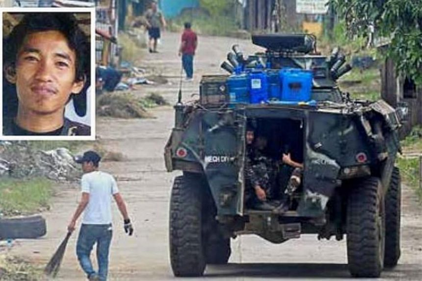 An armoured vehicle moving along in Bangon district, Marawi City, where Amin Baco was hiding in a mosque.
