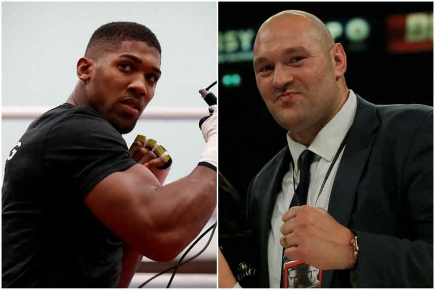 Boxer Anthony Joshua (left) has not ruled out a clash with rival Tyson Fury, despite the latter having said he will not reapply for his boxing licence after it was stripped from him.