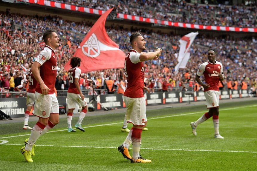 Arsenal's Sead Kolasinac celebrates scoring their first goal on Aug 6, 2017.