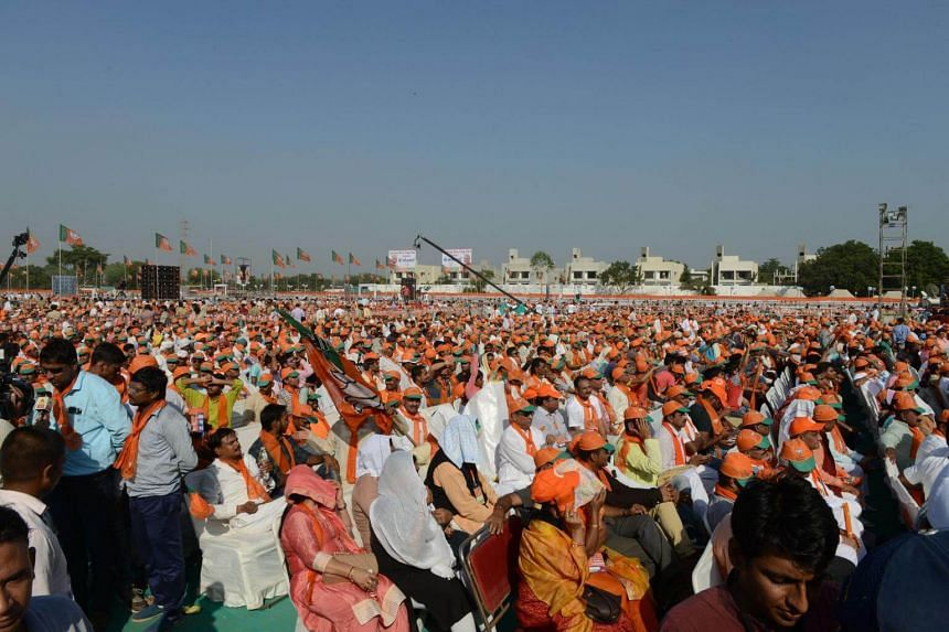 Supporters assemble to a gathering of Bhartiya Janta Party (BJP) during Gujarat Gaurav Mahasamellan at Bhaat village on the outskirts of Ahmedabad on Oct 16, 2017. The party has ruled the western state for more than two decades.