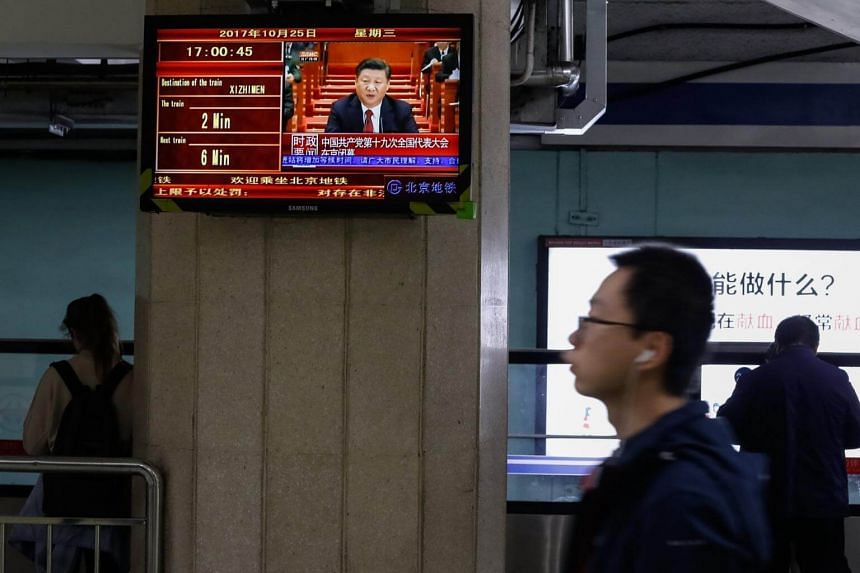 A news report on Chinese President Xi Jinping speaking at the 19th National Congress being shown on a subway station screen in Beijing on Oct 25, 2017.
