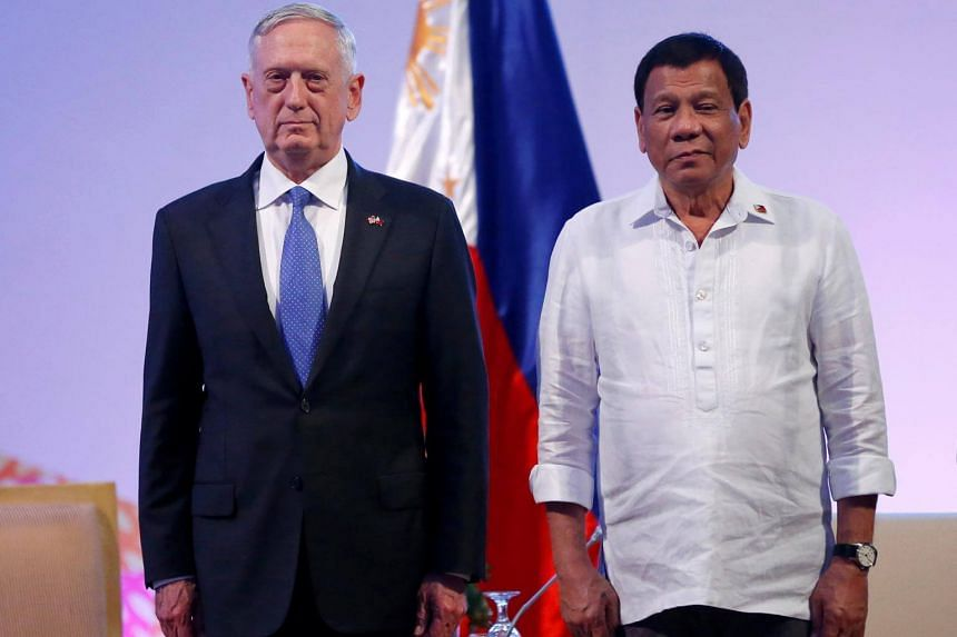 Philippine President Rodrigo Duterte stands with US Defence Secretary James Mattis (left) during a courtesy call at the 11th Association of Southeast Asian Nations Defence Ministers' meeting on Oct 24, 2017.