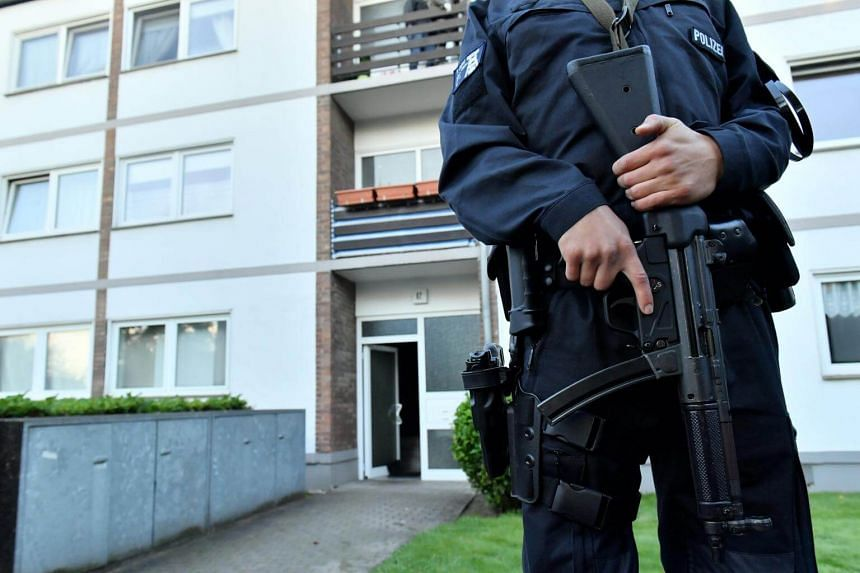 German police officers arrested a 40-year-old man, alleged to be a militant, and also seized a cache of weapons in a series of raids in Berlin.
