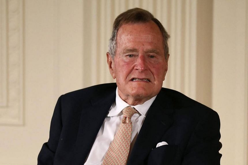 Former US President George H. W. Bush at an event in the East Room at the White House in Washington, DC on July 14, 2013.