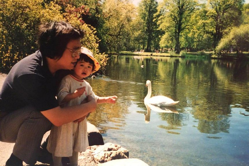 Angela Gui as a child with her father Gui Minhai, who disappeared on Oct 17, 2015.