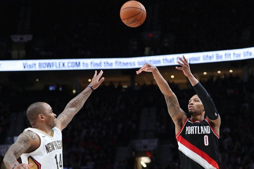 Portland Trail Blazers guard Damian Lillard shooting over New Orleans Pelicans guard Jameer Nelson during their NBA match on Oct 24, 2017.