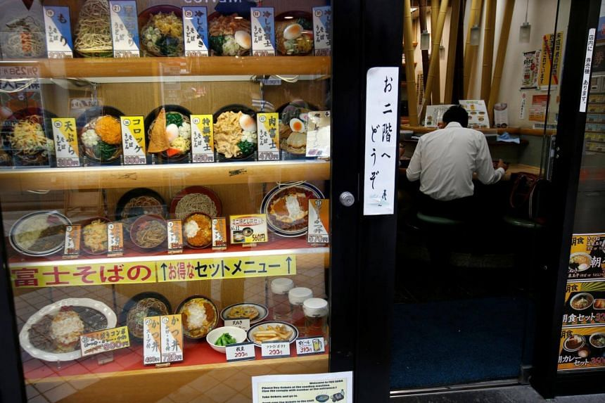 Food samples are displayed outside a shop of Famed Fuji Soba, a Japanese noodle shop chain, in Tokyo on Sept 26, 2017.
