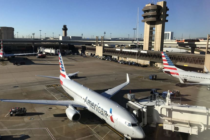 An American Airlines plane at the gate at Dallas Fort Worth International Airport in Dallas, Texas.