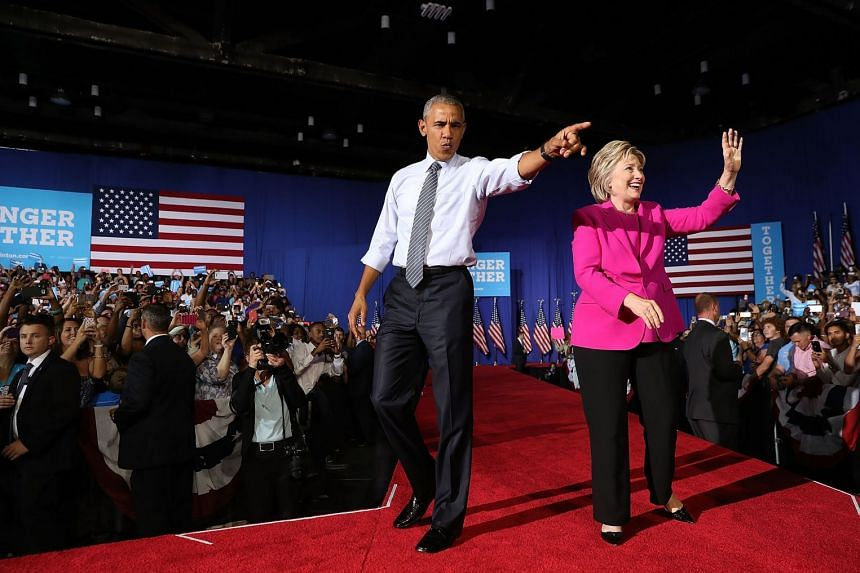 Former US president Barack Obama and former Democratic presidential candidate Hillary Clinton campaigning in July 2016.