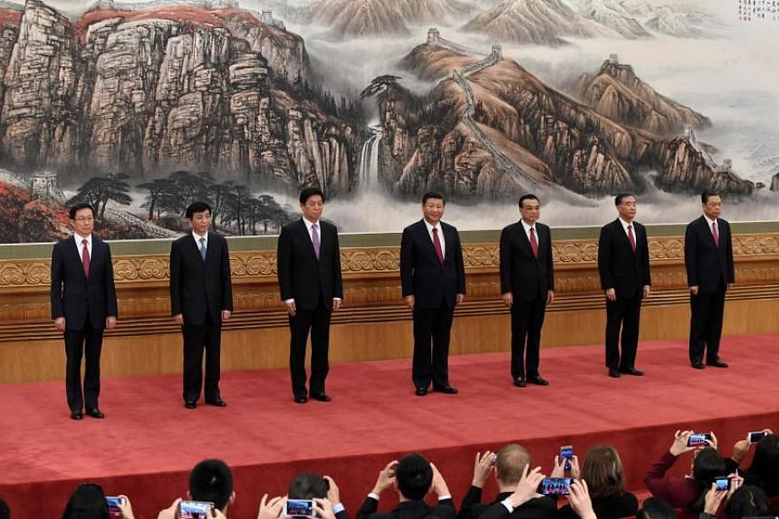 The Communist Party of China's new Politburo Standing Committee, (from left) Han Zheng, Wang Huning, Li Zhanshu, Chinese President Xi Jinping, Premier Li Keqiang, Wang Yang and Zhao Leji meet the press at the Great Hall of the People in Beijing.