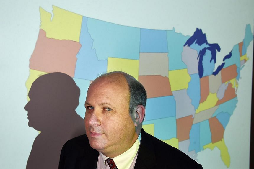 Marc Elias of Perkins Coie poses for a portrait in front of a projected map of the United States at the firm in Washington, DC.