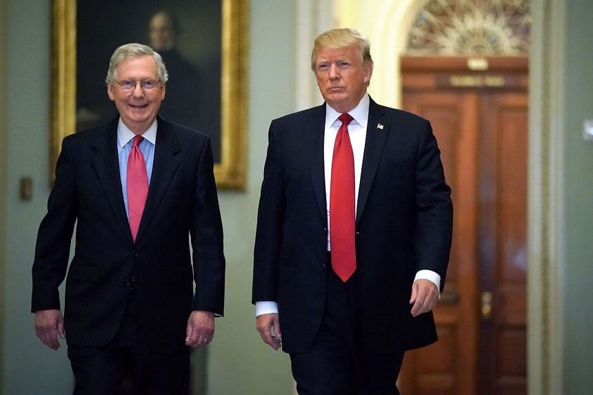 Senate Majority Leader Mitch McConnell (left) and Trump arrive at the US Capitol, Oct 24, 2017.