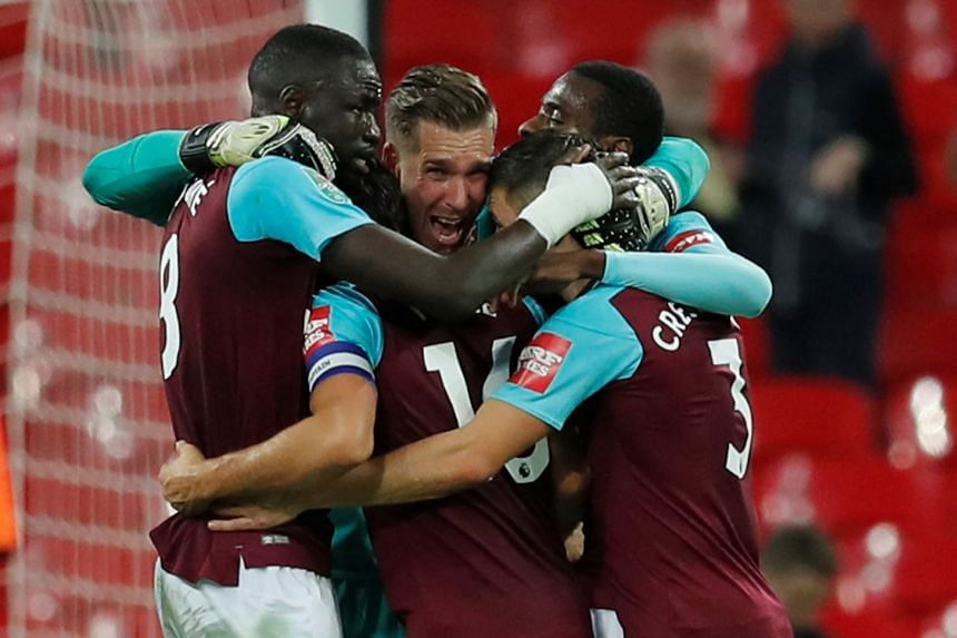 West Ham United's Adrian and team mates celebrate after the match.