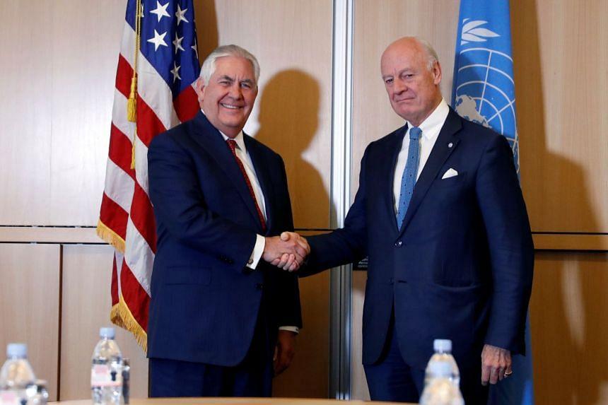 Mr Rex Tillerson shakes hands with UN Special Envoy for Syria Staffan de Mistura in Geneva.