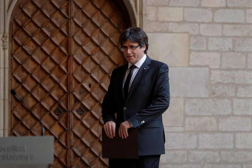 Catalan President Carles Puigdemont arrives to deliver a statement at the regional government headquarters in Barcelona.