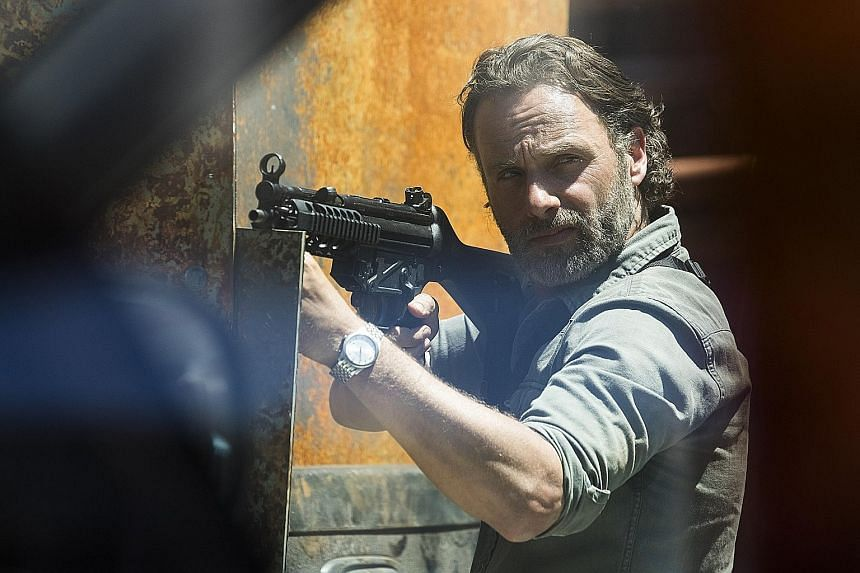 Actor Andrew Lincoln (left) stars in the eighth season of the drama series, The Walking Dead.