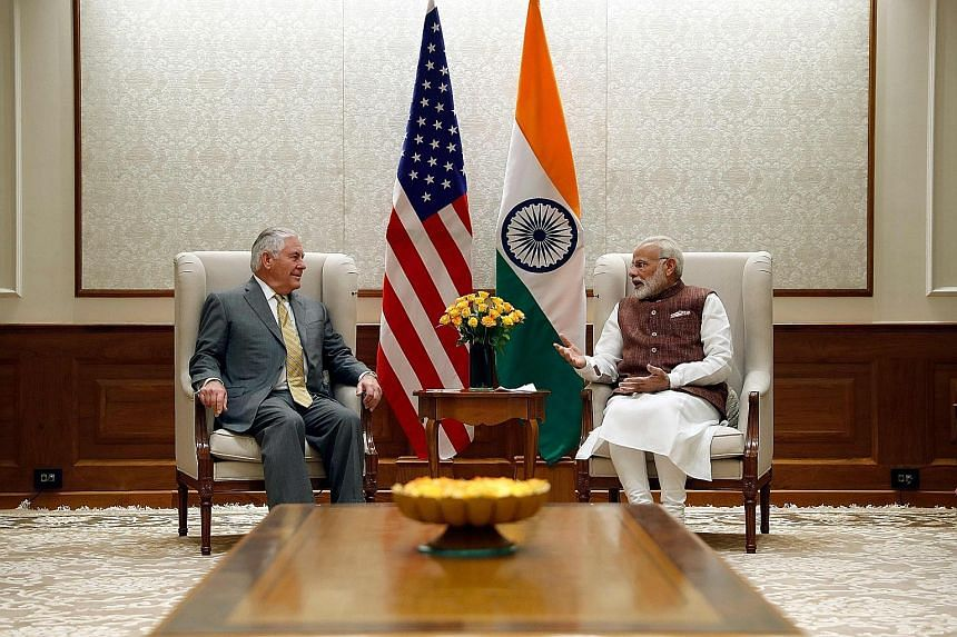 """US Secretary of State Rex Tillerson and Indian Prime Minister Narendra Modi at the latter's residence in New Delhi yesterday. Mr Modi's office said both of them discussed """"stepping up effective cooperation to combat terrorism in all its forms, and pr"""