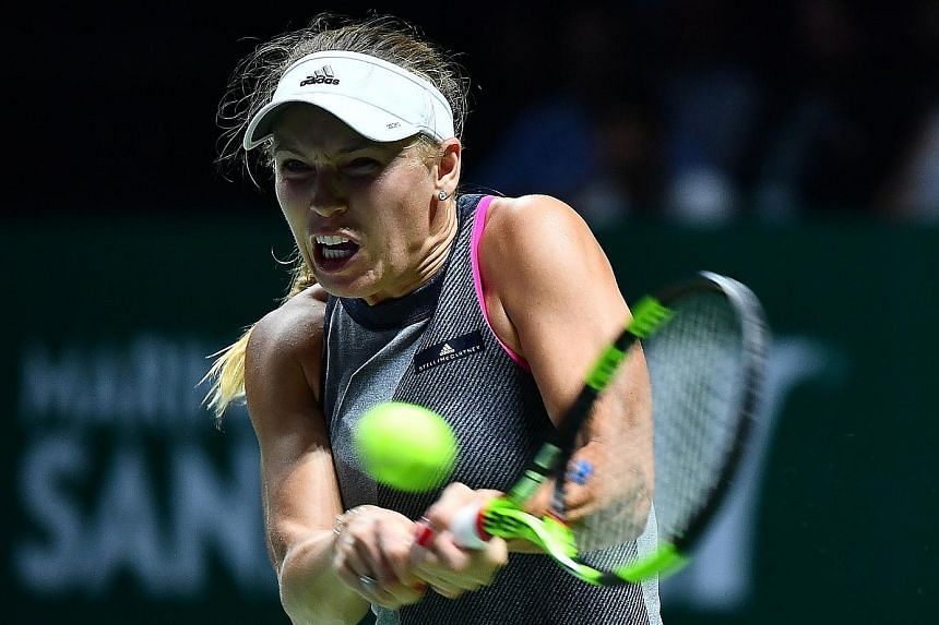 World No. 6 Caroline Wozniacki leaving world No. 1 Simona Halep of Romania with no answer to her power play and accurate ground strokes in their Red Group tie. The Dane, who has been in imperious form in her two WTA Finals Singapore matches, advances