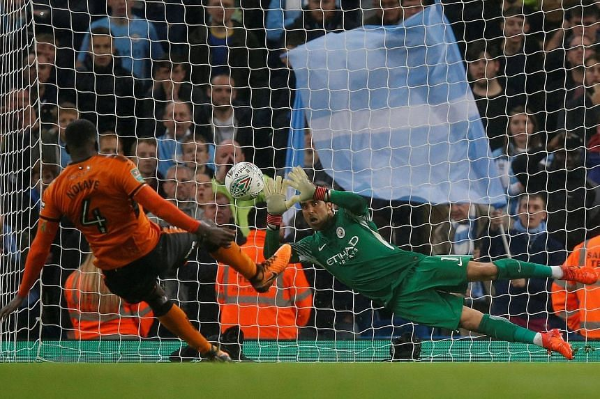Manchester City's Chilean custodian Claudio Bravo saving Wolves midfielder Alfred N'Diaye's penalty in the shoot-out that City won 4-1. A squirrel running onto the pitch before kick-off was one of the game's few high points.