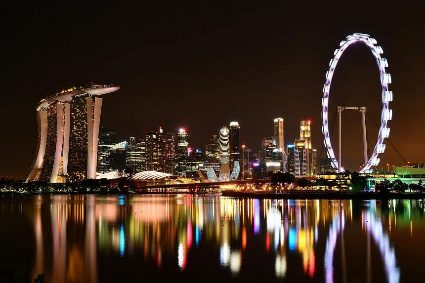 Skyline of Singapore Central Business District at night.