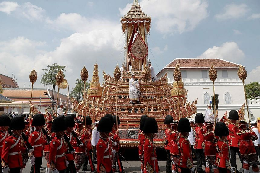 The Great Victory Chariot carrying the Royal Urn of Thailand's late King Bhumibol Adulyadej is pulled during a royal cremation procession at the Grand Palace in Bangkok.