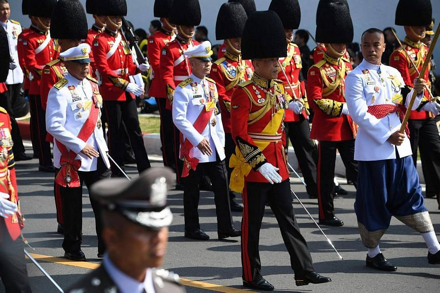 Thai King Maha Vajiralongkorn (centre) takes part in the funeral procession for his father, the late Thai king Bhumibol Adulyadej, in Bangkok.