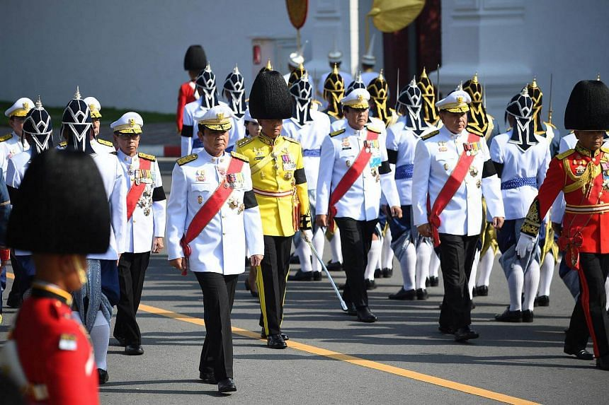 Thailand's Prime Minister Prayuth Chan-o-cha (front left) takes part in the funeral procession for the late Thai king Bhumibol Adulyadej in Bangkok.