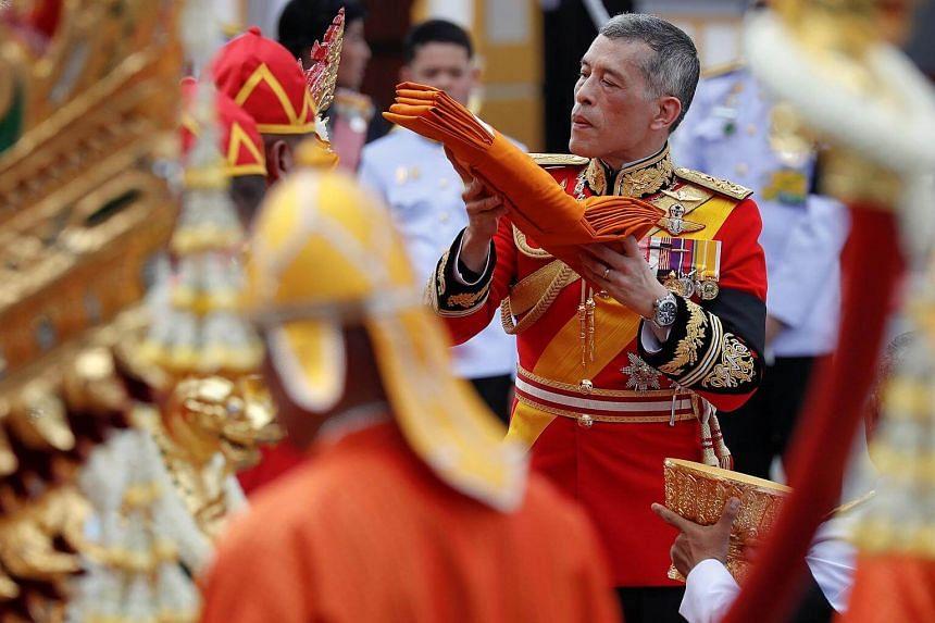 Thailand's King Maha Vajiralongkorn takes part in the royal cremation procession of late King Bhumibol Adulyadej at the Grand Palace in Bangkok.