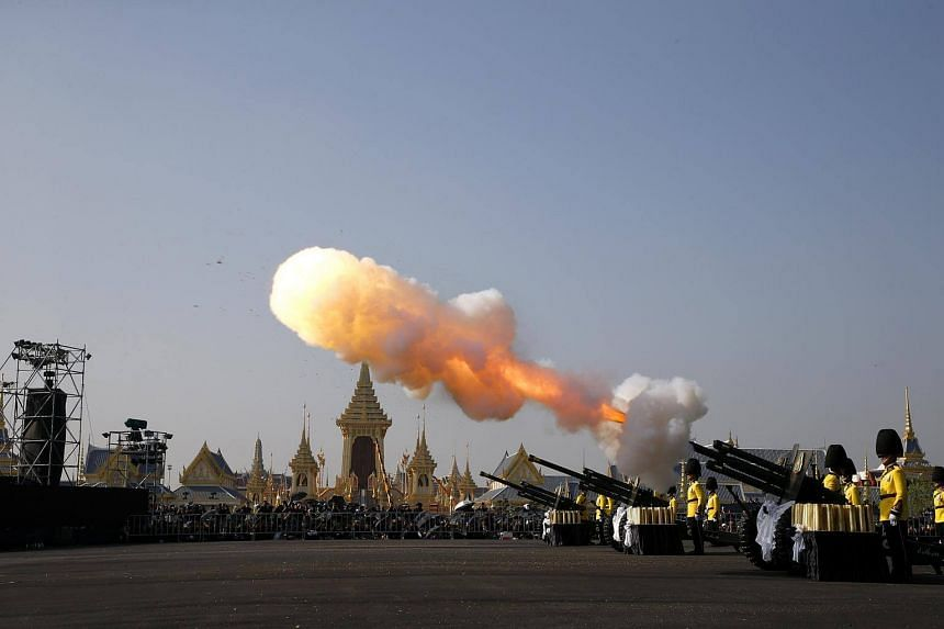 Artillery salute at the start of the royal cremation ceremony near the Royal Palace in Bangkok.