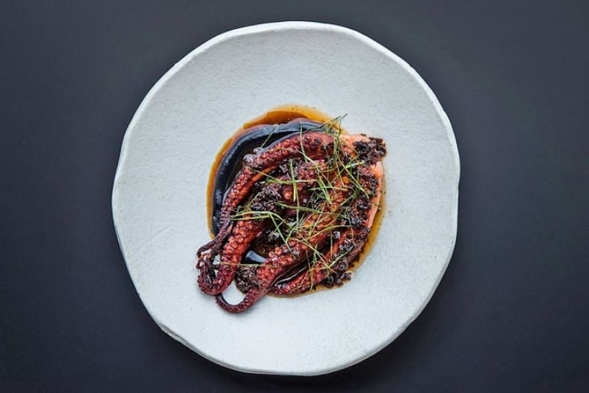 Octopus with XO red wine vinaigrette - chunks of octopus swathed in a thick, unctuous sauce, an unexpected liaison of squid ink, XO sauce and red vinegar. P
