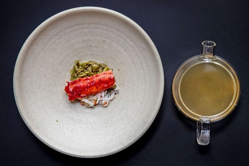 King crab and braised pumpkin seeds in pepper broth (S$32) - a delicate yet full-bodied shellfish broth that you scoop up with strands of crabmeat and softened pumpkin seeds before attacking the chunk of crab leg on top.
