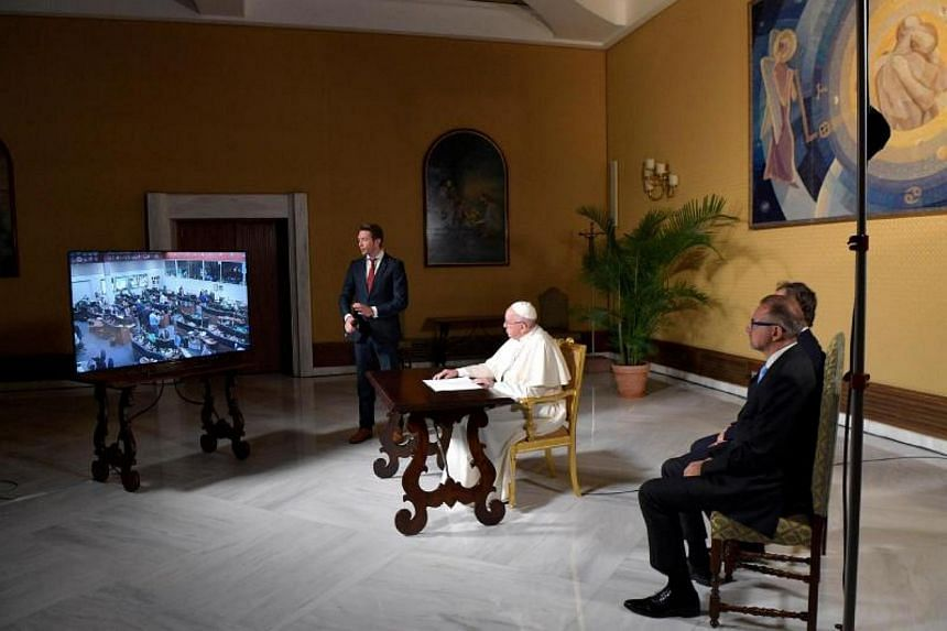 Pope Francis (centre) at a video conference with the International Space Station (ISS) at the Vatican on Oct 26, 2017. He chatted with six astronauts at ISS.