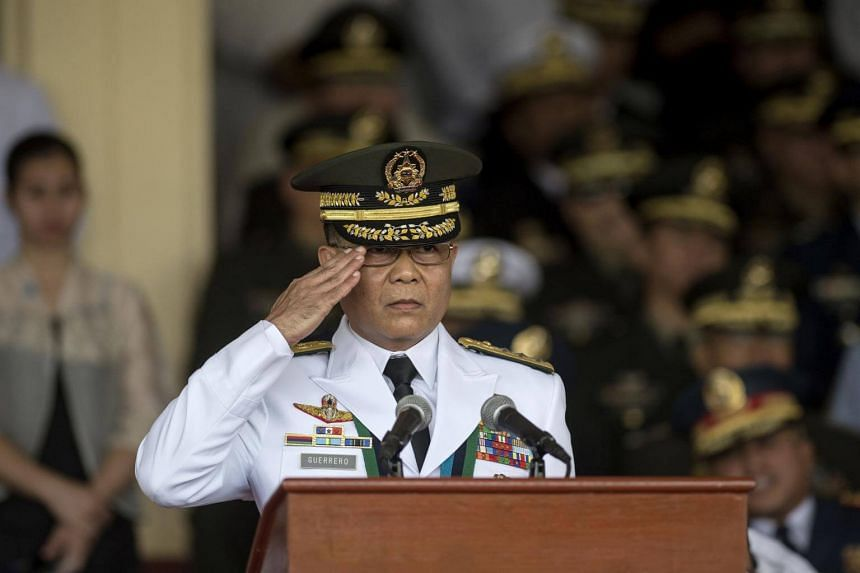 Incoming Armed Forces of the Philippines chief Rey Leonardo Guerrero gives a salute during the change of command ceremony at Camp Aguinaldo in Manila on Oct 26, 2017.