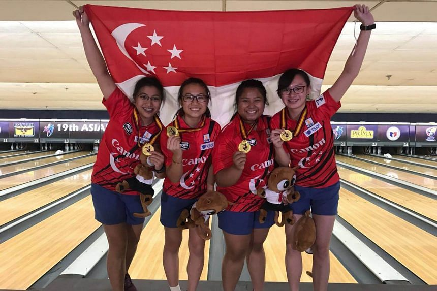 (From left) Jermaine Seah, Charlene Lim, Illiya Syamim, and Amabel Chua took gold at the Asian Youth Tenpin Bowling Championships in the Philippines, emerging tops in the girls' team event on Oct 26, 2017.