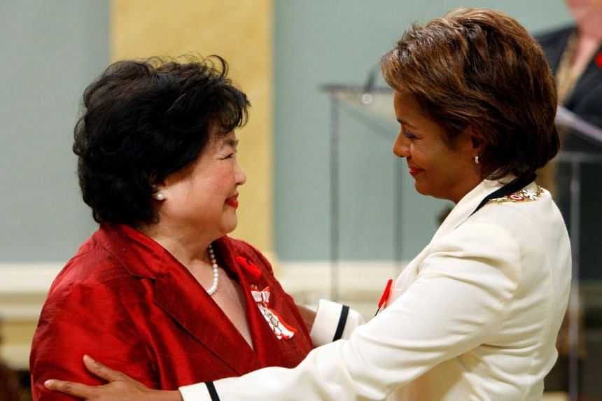 Setsuko Thurlow (left), a survivor of the Hiroshima atomic bombing, is congratulated after being awarded the rank of Member in the Order of Canada by Governor General Michaelle Jean at Rideau Hall in Ottawa on Oct 26, 2017.