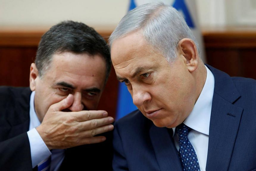 Israeli Prime Minister Benjamin Netanyahu (right) and Intelligence Minister Israel Katz during the weekly cabinet meeting at his Jerusalem office on Sept 26, 2017.