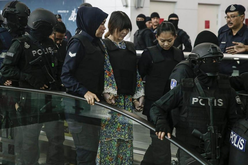 Doan Thi Huong (centre) who is on trial for the assasination of Kim Jong Nam, is escorted as she revisits the scene of the attack at Kuala Lumpur International Airport 2 in Sepang, Malaysia, on Oct 24, 2017.