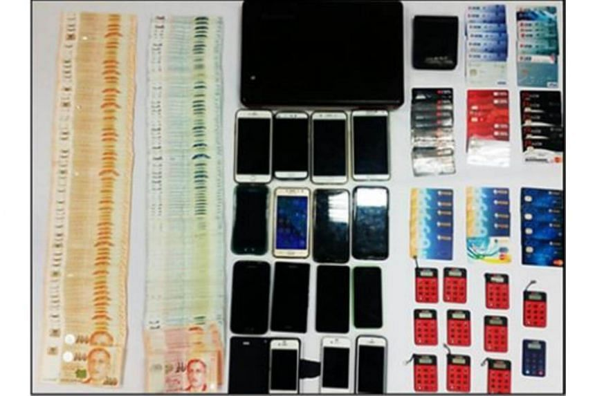 The police seized various items as case exhibits in this operation, including $24,768 in cash, mobile phones, ATM cards, Internet banking dongles and a laptop.