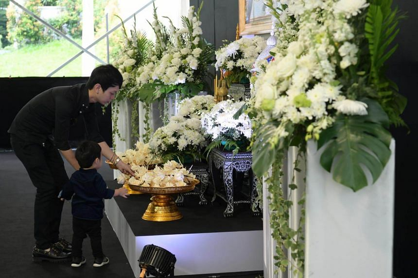 Mourners pay their respect to the late Thai king at the Royal Thai Embassy in Orchard Road on Oct 26, 2017.