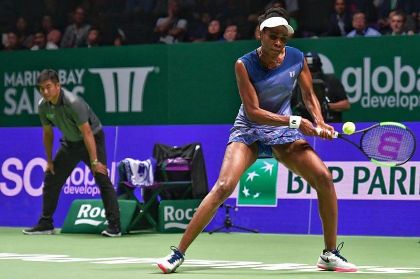 Venus Williams in action against Garbine Muguruza at the WTA Finals Singapore on Oct 26, 2017.