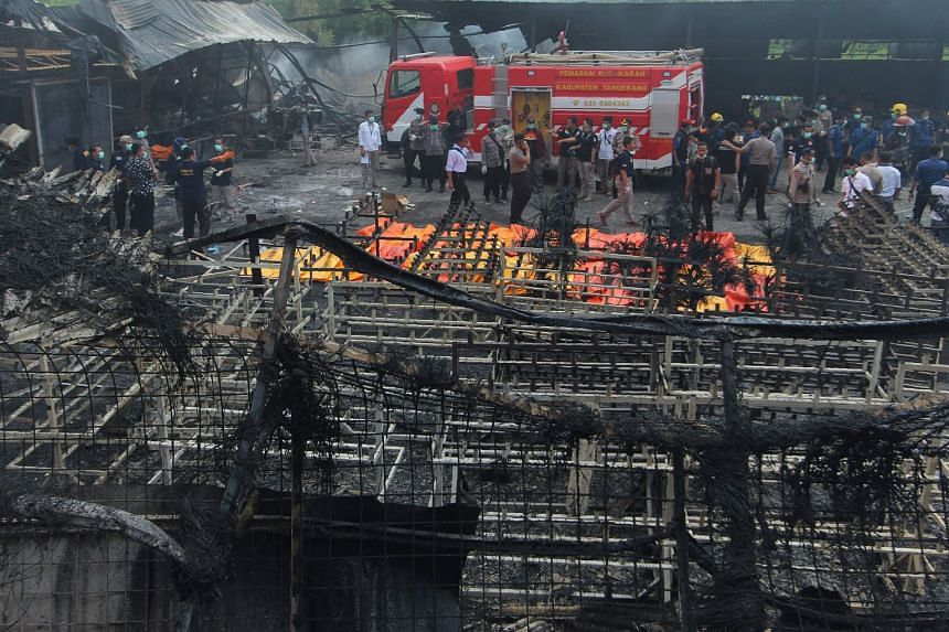 Indonesian forensic policemen working after a fire disaster in Tangerang Kota, Banten province, on Oct 26, 2017.