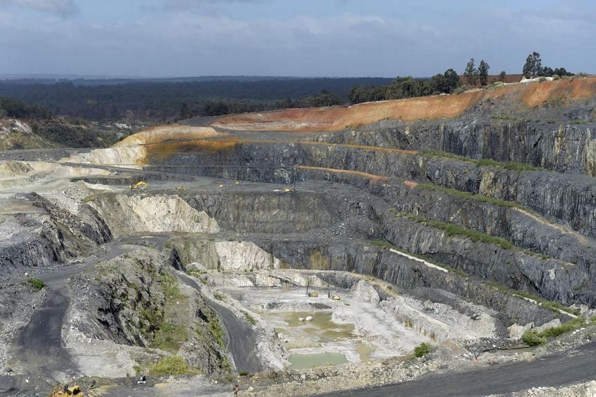 Lithium ore is mined in the open pit at a Talison Lithium Ltd site, a joint venture between Tianqi Lithium Corp and Albemarle Corp, in Greenbushes, Australia.