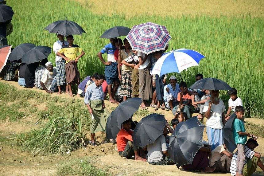 Rohingya refugees wait for relief aid at Balukhali refugee camp in the Bangladeshi district of Ukhia.