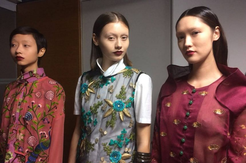 Models wait backstage before the Laichan show at Singapore Fashion Week 2017.